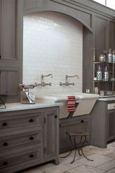 grey cabinets, white subway tile and that sink, that sink is off the hook!