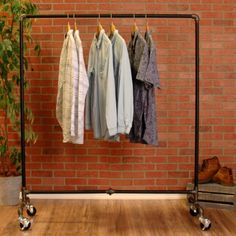 Industrial Pipe Clothing Rack by William Roberts Vintage William Roberts Vintage Industrial Pipe Clothes Rack is made using black pipe and pipe fittings. This extremely durable and long-lasting design Rolling Clothes Rack, Pipe Clothes Rack, Clothes Drying Racks, Rolling Rack, Industrial Clothes Racks, Heavy Duty Clothes Rack, Rolling Storage, Clothes Dryer, Industrial Pipe