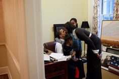 President Barack Obama visits with his daughters Malia and Sasha and kisses his wife, First Lady Michelle Obama, in a private study off the Oval Office, Feb. (Official White House Photo by Pete Souza) Michelle Und Barack Obama, Barack Obama Family, First Black President, Mr President, Greatest Presidents, American Presidents, American History, Joe Biden, Presidente Obama