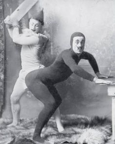 Antique vintage photo clown spanking a man in tights BDSM kink