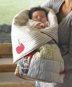 sleeping bag for baby and unzips to a playmat- what a great idea. And their little toes don't poke out.