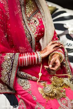 An Indian bride and groom get ready for their wedding celebrations.