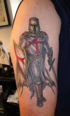 Thinking of getting a tattoo like this except remove the templars crosses, color the fabric a shade of blue and add  blue angel wings to the knight.