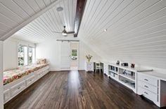 Great use of attic space. Love the twin beds along the left and the desks and work space on the right. Hardwood or laminate floors are great. Sliding barn door. Love it all!