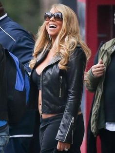 Mariah Carey rocking a black crop top, black leather jacket, and oversized sunglasses. #mariahcarey