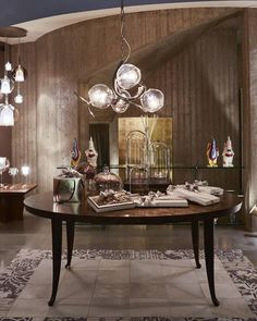 Recently our Italian partner E' LUCE welcomed several of our new collections in their showroom, including this Ersa  and Louise. For more information about our 2018 collections, please visit our website. Modern Dining Room Lighting, Modern Lighting Design, Modern Floor Lamps, Custom Lighting, Interior Lighting, Italian Interior Design, Classic Interior, Unique Table Lamps, Contemporary Chandelier