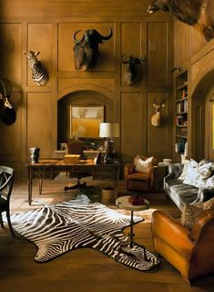 A beautiful zebra cowhide rug on the floor. Dear mount on the wall.Bring African adventure in your living room! Safari Home Decor, Safari Decorations, Masculine Home Offices, African Home Decor, Traditional Interior, African Safari, Old Buildings, Room Decor, Elegant