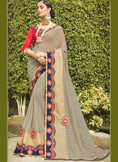 Shop latest online sarees collections at best price. Order this flawless embroidered and patch border work classic designer saree for festival and party.