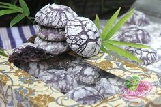 """Chewy and Moist Ube Crinkle Cookie Recipe - One of the most popular cookies, it has a crunchy exterior, moist on the inside and coated with powdered sugar on top for a sweet touch. These cookies are made from ube halaya """"purple yam jam"""", sugar, oil, eggs, flour and confectioner sugar."""