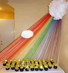 Rainbow decor and pots of gold favors from a Rainbow Party #rainbowparty #potofgold