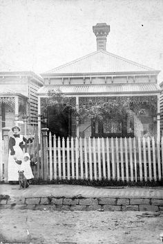 1902 A woman, wearing an apron, a small child and a dog at the gate of a small house. There are vines growing on the verandah. There is a deep gutter lined withn two rows of bluestone blocks. Melbourne Victoria, Victoria Australia, Melbourne Suburbs, Australian Homes, Australian Architecture, Melbourne Australia, Brisbane, Sydney, Australian Continent