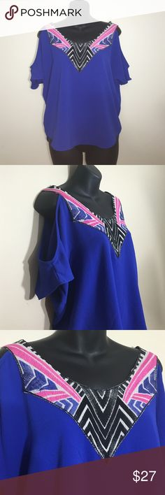 Super fun cold shoulder short sleeve Royal blue with cut out shoulder accent. Pink,black and blue geo theme neck line with deep V back. One of the better fitting cold shoulders I have. Tops Blouses