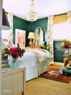 Green walls, abstract art and a chandelier