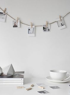 A great DIY for hanging up pictures. All you need is some string and a few wooden pegs. DIY picture hanging. inkifi.com
