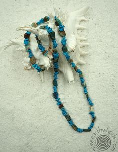 Summer white - blue opal and turquoise - a match made in heaven!  http://earthwhorls.com/products/1477sn