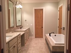 Large soaker tub, granite counter tops, custom framed mirrors, and detailed tile