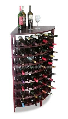 x x Another unique corner wine rack. Shown here in Mahogany finish on Maple wood. Store 'em and pour 'em with this rack. Features solid wood top and true radius shelves for stylish wine storage. Wine Rack Cabinet, Wine Rack Storage, Wine Shelves, Kitchen Shelves, Corner Wine Rack, Wine Corker, Pallet Wine, Wood Wine Racks, Expensive Wine