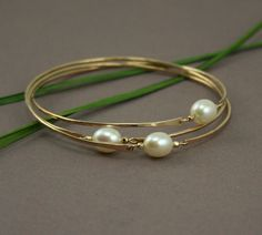 Skinny Gold bangles, Interlocking gold bangles with freshwater pearls