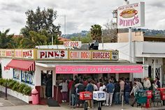Hollywood, California: Pink's Hot Dog Stand is near the corner of Melrose and La Brea. Get ready to stand for a long time...but it is so worth the wait for the taste and the nostalgic experience. It's a favorite eating place for the Hollywood stars. This picture was taken six years ago, so the sign now reads 72 years!! They've been in this spot since 1939.