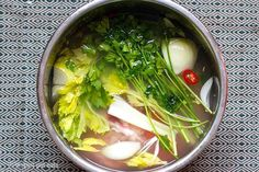 Organic bone broth with chicken, herbs and veggies made in 3 hours instead of 12 using an Instant Pot pressure cooker. Here is how to do it.