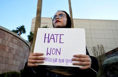 """Cupcakes and snowflakes unite-Sign reads: Hate won, America was never great   One might ask ourselves who is this person holding the sign?  """"At suicide hotlines, the first 24 hours of Trump's America have been full of fear"""" - The Washington Post"""