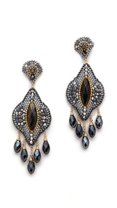 These statement-making Miguel Ases earrings shimmer with Swarovski crystal accents. 14k gold-fill post closure.  Made in the USA.  Measurements Length: 3in / 7.5cm $388.00  Made in the USA.  Measu...