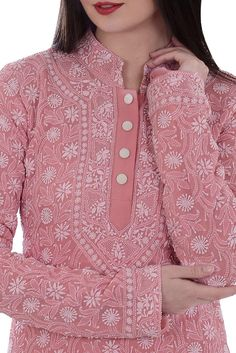 This is a salmon pink pure georgette hand embroidered all over intricate chikankari kurta. The kurta has ivory chikankari floral jaal all over front, back and sleeves. The kurta has a band collar and 7 inches long front open plackett with hook cl Salwar Designs, Kurta Designs Women, Kurti Designs Party Wear, Neck Designs For Suits, Neckline Designs, Dress Neck Designs, Blouse Designs, Indian Dresses, Indian Outfits