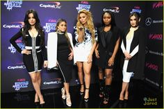 Fifth Harmony Hit Up Z100's Jingle Ball After Candie's Winter Bash Concert - See All The Pics!: Photo #905217. Fifth Harmony raise their arms for a group bow after performing at Z100's Jingle Ball 2015 held at Madison Square Garden on Friday night (December 11) in New York…