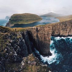 """""""Even standing above it all and looking out, our minds struggled to take in the beauty and depth of the craggy ocean landscape."""" -@muenchmax Faroe Islands #passionpassport"""