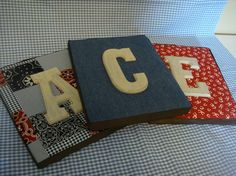 Totally making some of these for the lil' one's Initials to hang on the wall. love the vintage fabric behind the raised wood letters.