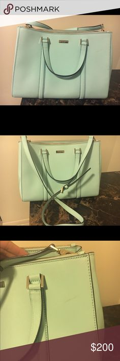 Kate Spade purse Pale blue purse, with two short straps or one longer strap, good for side shoulder over across shoulder! Has a tiny scratch on the front, I've never tried to get it off with anything besides water so it may come off. Used a few times. kate spade Bags