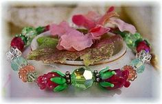 Glass Lampwork Rose of Sharon Bead w/Swarovski Chrysolite Crystal Bracelet $32 by HisJewelsCreations