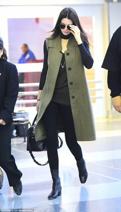 Jet setter: Kendall Jenner sported a chic camel vest with an olive and grey blouse on Thur...