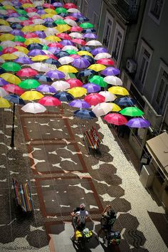 Another view of the famous hanging umbrellas in Portugal. The article has lots more pictures.