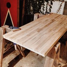 Farm table made with re-purposed hardwood flooring. All that's left to do it put on the legs.