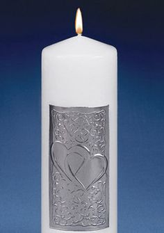 Show your guests that your hearts are linked as one with our Silver Double Heart Unity Candle.  Available in white or ivory, this elegant unity candle features an intricate silver scroll detailing around a double heart.Tapers not included.