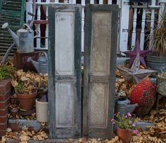Here we have an antique pair of old wooden paneled shutter doors off of and old historic home in Pennsylvania.These shutters are a fabulous distressed green and white color with the original iron hardware on them still. Great for bringing a rustic / farmhouse feel to the home :)  Each shutter door measures approx 60 tall x 14 1/2 wide. Rustic distressed condition but still strong and solid.  Many more pairs of antique shutters in our Etsy shop for all of your home decorating needs :...
