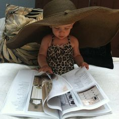 Baby with floppy hat reading magazine. FABULOUS!!  hey wait it's PIPER!