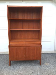 A personal favorite from my Etsy shop https://www.etsy.com/listing/609531222/teak-hutch-bookcase-danish-modern