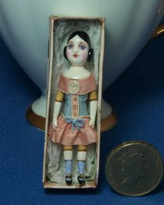 12th scale model of a Victorian toy doll in an by GaleElenaBantock
