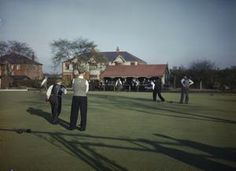 """RECREATION FACILITIES FOR WORKERS AT A FACTORY IN BRITAIN, 1944  part of """"MINISTRY OF INFORMATION SECOND WORLD WAR COLOUR TRANSPARENCY COLLECTION"""" (photographs) Made by: Ministry of Information official photographer  TR 1732  A game of bowls at a sports ground run by a large glass factory in the north of England."""