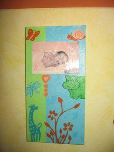 Quadretto in tela in canera di mio figlio con una sua foto appena nato