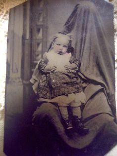 """Usually during the victorian era, photograpy was very expensive and alot of familys photos were taken after their family member passed away. This ended up being the ONLY photograph poorer people kept. They are held up, stood up, fixed into a """"stand"""" like object so they appear alive."""