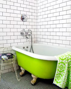 Love the floor tile + subway tile + lime green tub (House and Home)
