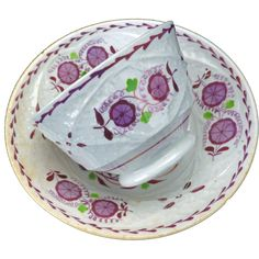 Pink Lusterware/ Lustreware Teacup and Saucer with a molded design of a vine forming quadrafoil reserves. Inside each reserve are stylized flowers