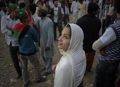 International Women's Day: Fatima, 21, a supporter of the political party Pakistan Tehreek-e-Insaf (Pakistan's Movement for Justice) looks up as she attends a rally in Karachi, December 25, 2011.  REUTERS-Insiya Syed
