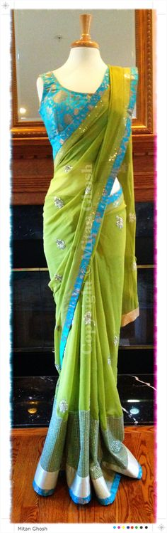 Green georgette saree with dabka motifs. Blouse is made of Banarsi khinkhwaab.