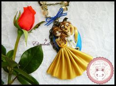 Beauty and the Beast Necklace  SINGLE PIECE  String color gold old 50cm Cameo old gold color and embellishment made from polymer clay (8cm)  It includes a pair of earrings of pink     Shipments The shipment will be held 3 - 5 days after making your payment. Through FedEx to Mexico and Mexican Postal Service (Correos de Mexico) for other countries < 3.  Delivery time: -Mexico 3 days -Other countries: 3 - 6 weeks    * Is the responsibility of the buyer to track your shipment with tracking t...