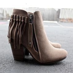 "- color: beige/tan color - contrasting side zip closure - fringe tassel back design - solid faux suede upper - cushioned insoles - 3"" approx. heel height - imported"
