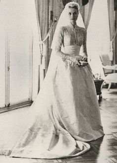 Grace Kelly. I adore her juliet cap and prayer book!